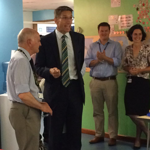 Southampton Consultant Orthopaedic Surgeon Mr Uglow congratulates Alan Rogers on his 50 year milestone.