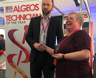 Karen Slater receives her technician of the Year award from Max Sheridan of Algeos